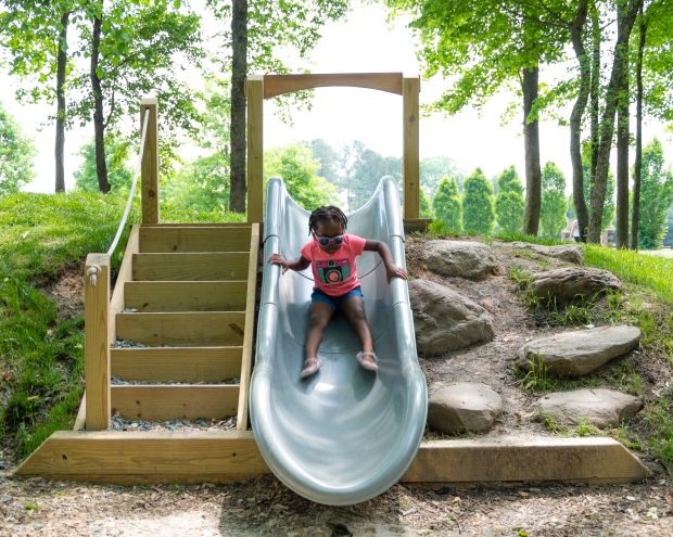Maxine is flying down the slide.